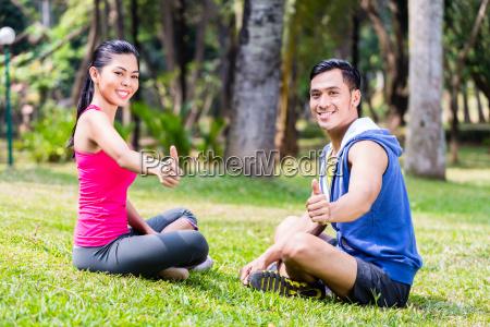 man and woman at sport gymnastics