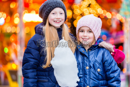 children eating sweet candy on christmas