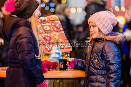 children on christmas market with gingerbread