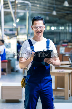 worker in asian production plant or