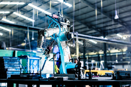 welding robot in production plant or