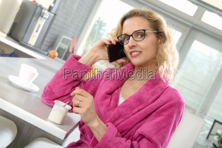 young blonde woman eating yogurt and