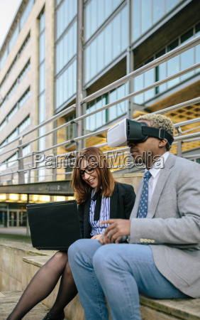 young businessman and woman using vr