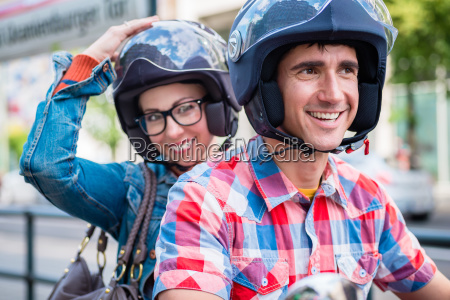 girl with glasses sitting on pillion