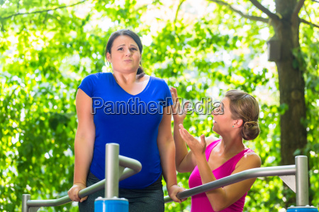 pregnant and obese woman during workout