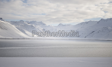 iceland water and snow covered mountains