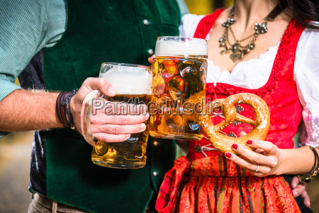 hands holding beer and pretzels detail