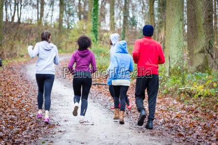 fitness trainer guiding group of four