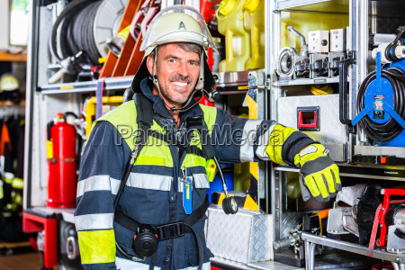 fire fighter in protective clothes leaning