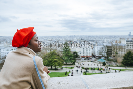 young woman in paris looking over