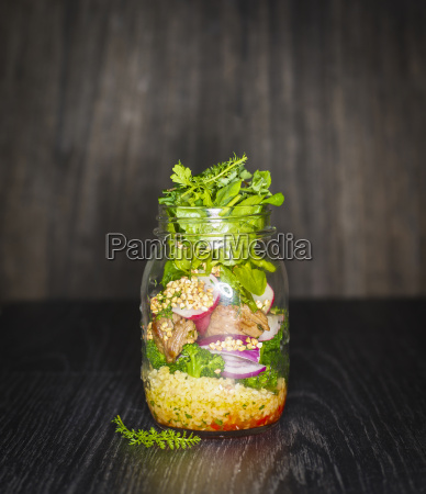 preserving jar of buckwheat salad with