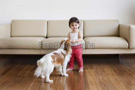 smiling toddler girl standing in the