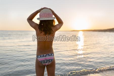 spain menorca girl watching the sunset
