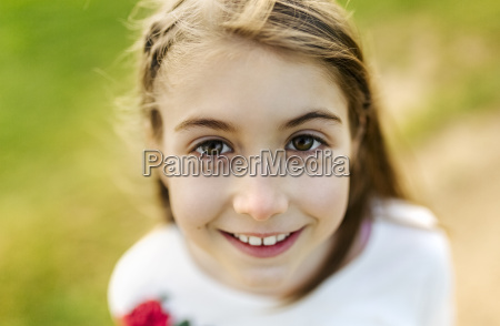 portrait of a smiling girl outdoors