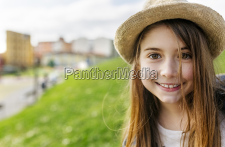 portrait of a smiling girl wearing