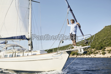 man standing on bow of his