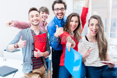 group of students celebrating success in