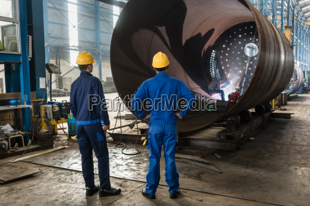 workers supervising the manufacture of a