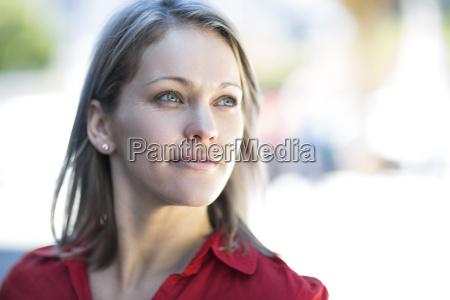 portrait of confident woman looking sideways