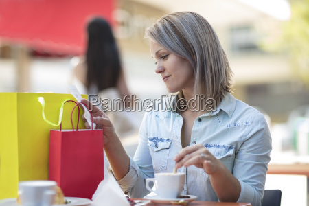 woman with shopping bags at an
