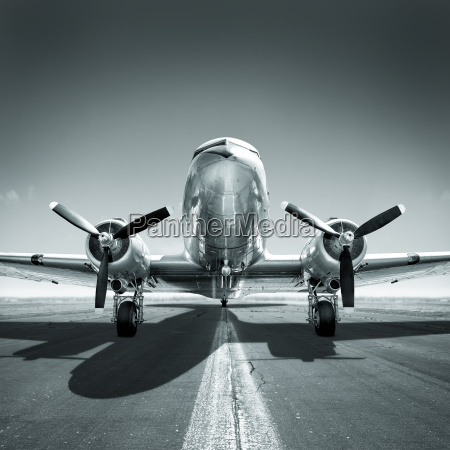 vintage aircraft on a runway