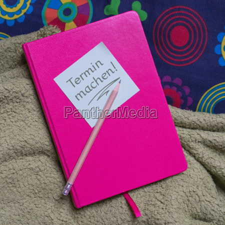 pink notebook pen and note with