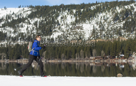 woman cross country skiing along donner