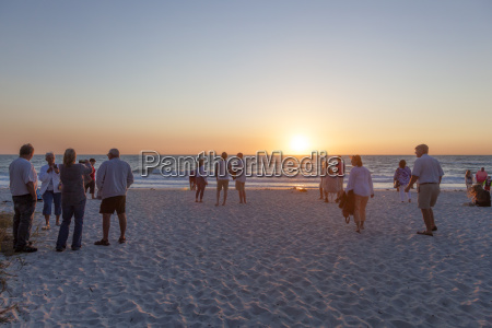 people watching sunset in naples florida
