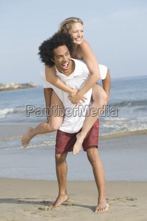 happy couple enjoying on beach