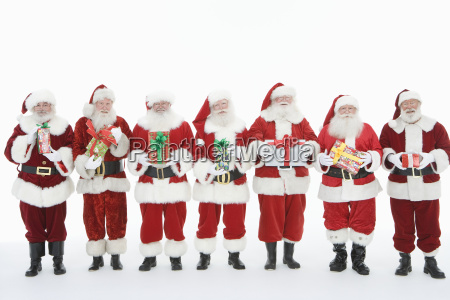 men dressed santa claus outfits standing