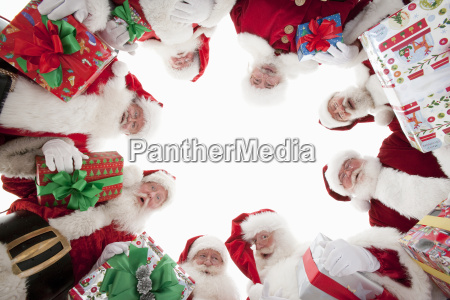 men in santa claus outfits forming