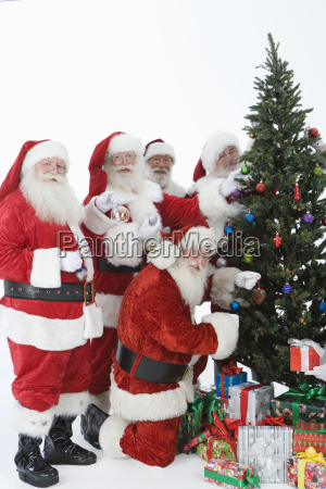 santa claus outfits decorating christmas tree
