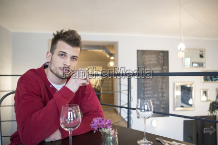 portrait of confident young man drinking