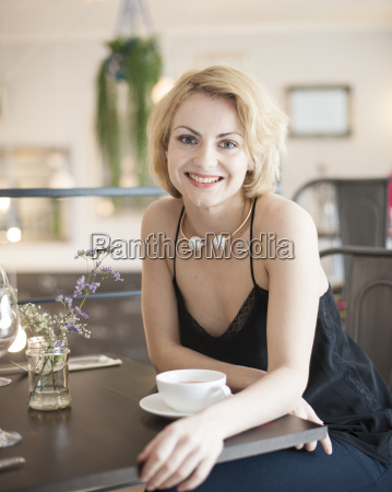 portrait of happy young woman sitting