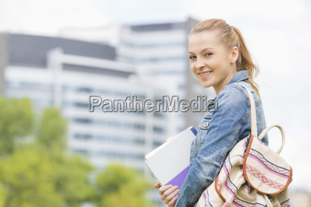 portrait of happy young female student