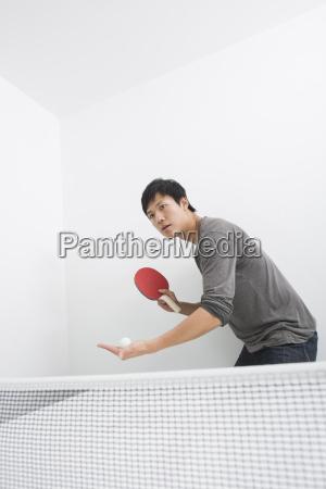 mid adult man preparing to serve