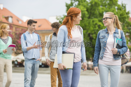 young college friends walking on street