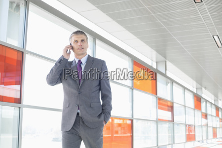middle aged businessman using cell phone