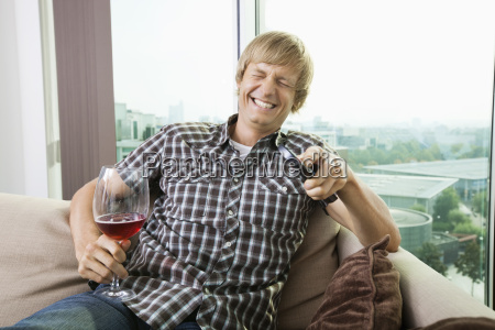 cheerful mid adult man with wine