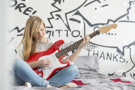 full length of teenage girl playing