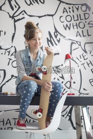 full length of girl with skateboard