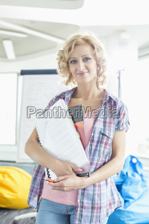 portrait of beautiful businesswoman holding files