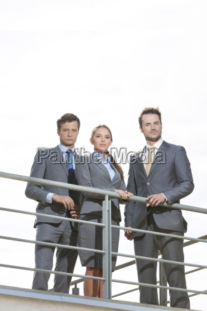 low angle view of businesspeople standing