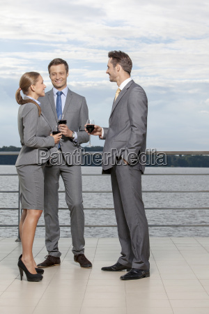 full length of smiling businesspeople with