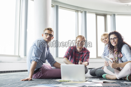 happy businesspeople looking away while working