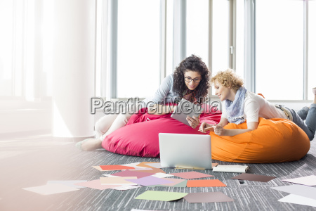 creative businesswomen using tablet pc while