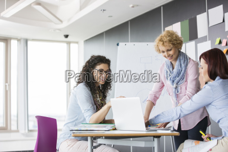 businesswomen working together in creative office