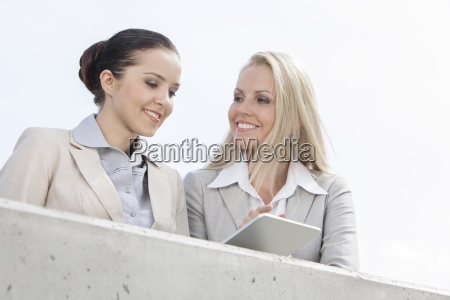 low angle view of smiling businesswomen