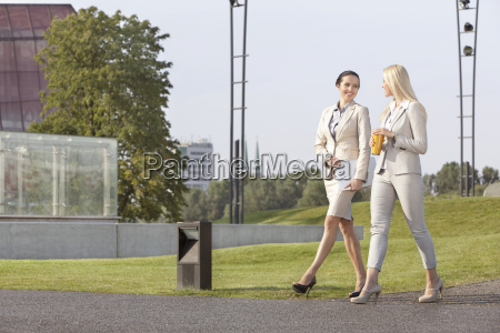 full length of young businesswomen looking