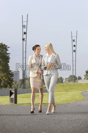full length of young businesswomen with